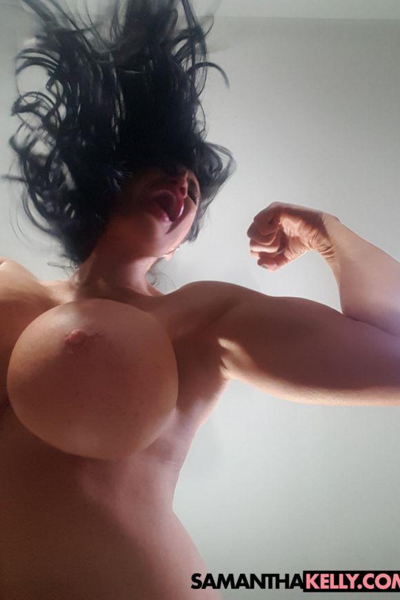Samantha Kelly bulging bicep flexing
