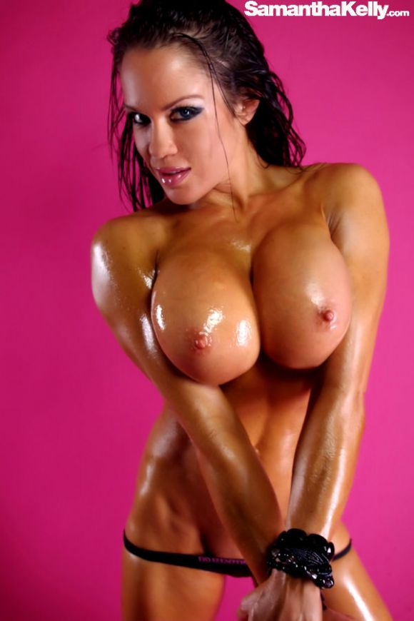 Samantha Kelly oiled up squeezing huge titties together