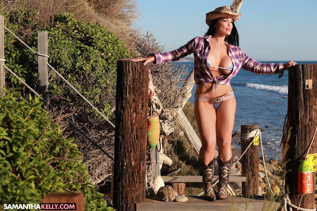 Samantha Kelly in a tiny bikini with huge boobs, tight body, cowgirl hat and boots thumb 1