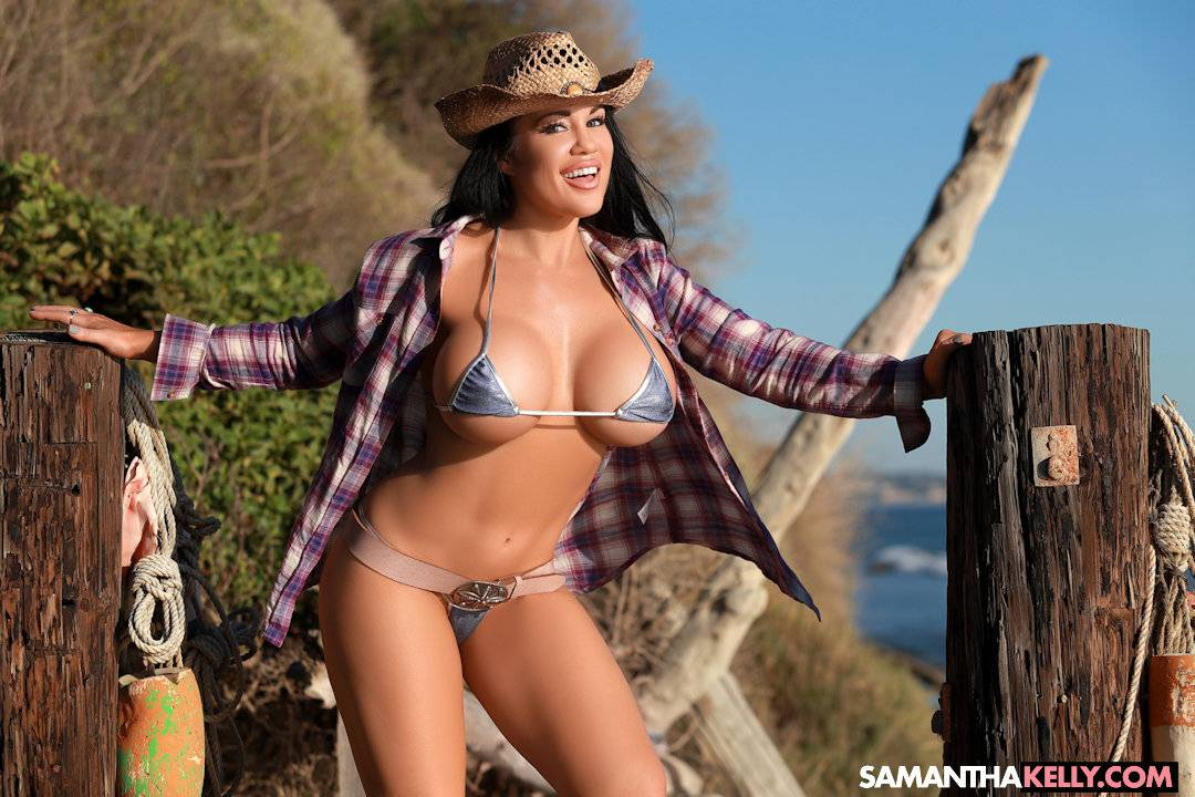 Samantha Kelly in a tiny bikini with huge boobs, tight body, cowgirl hat and boots thumb 2