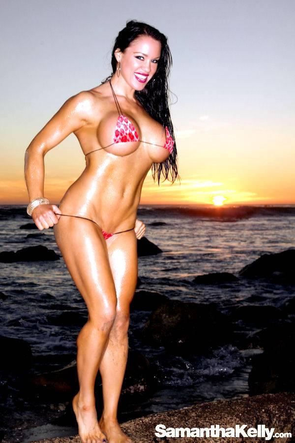 Samantha Kelly in the tiniest bikini shooting at sunset on Malibu Beach thumb 2