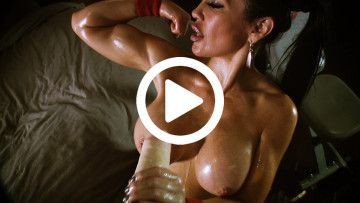 Samantha Kelly flexing her sexy biceps and stroking cock