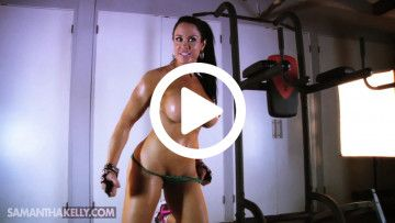 samantha kelly bicep flexing topless covered in oil